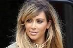 Kim Kardashian Attacks The Paparazzi!! (talk about biting the hand that feeds you!!)