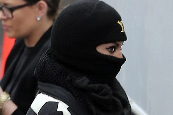 Unrecognizable Beyonce (that is her in burka-style head gear)