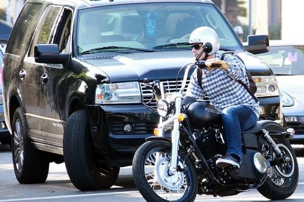 Josh Hutcherson almost knocked off his bike as he cuts off SUV (close call)