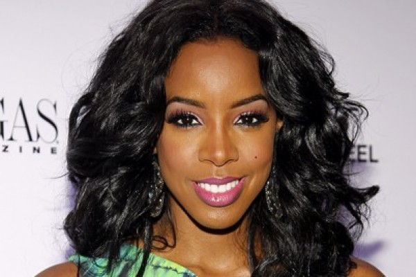 Kelly Rowland needs a bigger chair! Funny picture below