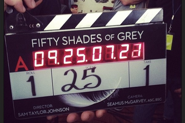 First picture of Jamie Dornan as Christian Grey in Fifty Shades of Grey. His tie is restraining someone!