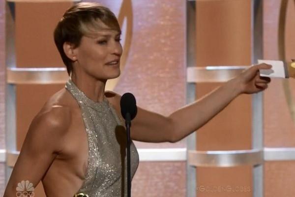 Robin Wright, 47, suffers wardrobe malfunction as she accepts Golden Globe award